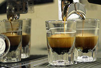 Buying coffee - espresso being poured